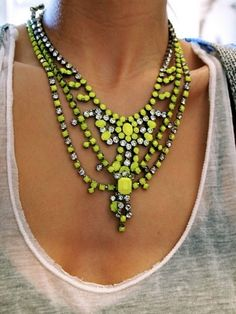 accessories can make all the difference - a simple t-shirt with a neon yellow necklace. done
