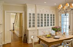 love the chairs and ceiling height cabinets