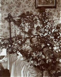 In Victorian death photos , they didn't use flowers as props. They were used to hide the smell of the body.