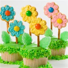 Flower Cupcakes: Celebrate spring with a batch of these delightful cupcakes. Arrange in a platter on a bed of grass green-tinted coconut.