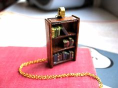 Great piece of jewelry for the bookworm in your life... A bookshelf necklace.