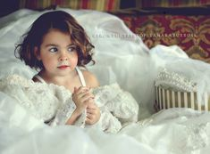 Take a pic of your daughter wearing your wedding dress, and then give to her on her wedding day.