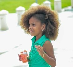 Fro pinned up to the side. And, I can't even deal with how cute this little girl is! #NaturalHair #afro