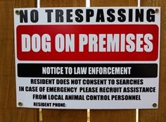 A sign to keep your dog from getting shot by police. Because God help them if they do...