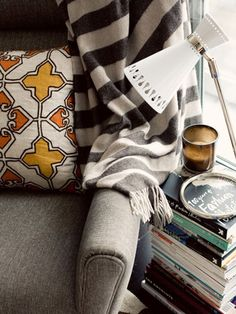 """""""I love creating small cozy spaces to curl up in,"""" Apartment 34's Erin Hiemstra says. """"Since we have limited square footage in San Francisco, I created an 'end table' out of my favorite design books and magazines."""""""