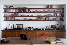 interior, office spaces, offices, wall shelving, music wall, wood shelves, desk, oscar niemeyer, workspac
