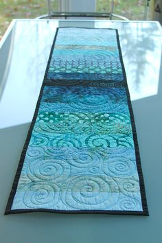 Quilted table runner by btaylorquilts. Good pattern to try different free motion quilting.