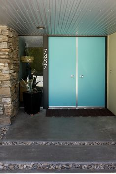 Mid-century turquoise doors and entryway