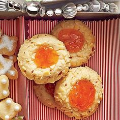 Apricot-Almond Thumbprints | Filled with orange apricot preserves, these decorative cookies are the perfect holiday treat for the table. | SouthernLiving.com