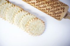 Laser engraved rolling pins - made to order.  You can have words or logos of your choice engraved. From Etsy.