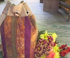 Learn to sew this sturdy drawstring wool bucket bag with this free sewing tutorial from Sue Bleiweiss.  This multi-purpose bag is an awesome autumn accessory. The round shape gives this bag a spaci...