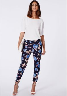 Gwen Floral Print Cigarette Trousers Navy is on sale now for - 25 % !