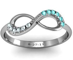 The Best Infinity Ring. With his and hers birth stones and Anniversary date.