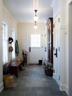 Slate floors, white walls, possibly palest blue tongue-in-groove ceiling, to pick up tones in floor.  Love the dark wood for accent!