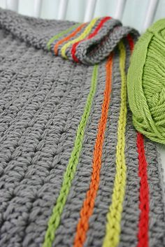 Crochet: cute way to add lines of color to a blanket or scarf.