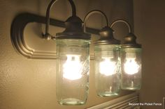 How to Makeover a Bathroom For Under $75, Fixing Up a Light Fixture http://bec4-beyondthepicketfence.blogspot.com/2013/10/how-to-makeover-bathroom-for-under-75_31.html
