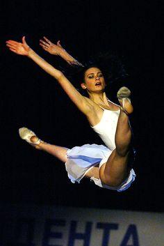 Rhythmic gymnast Tamara Yerofeeva performing split leg leap (2003).