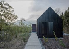 Blackened timber cottages added to a rural German resort. cottag