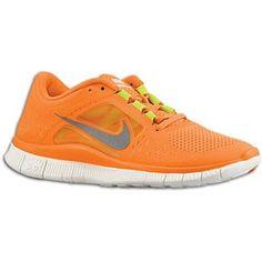 Orange Nike tennis shoes