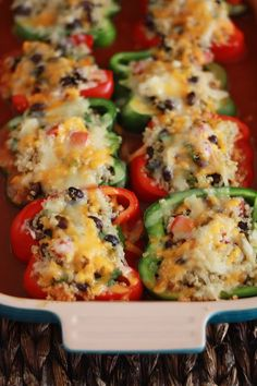 Mexican Stuffed Peppers with Quinoa & Black Beans  4 bell peppers, halved 1c quinoa, uncooked ½ med. onion, diced 15oz black beans, drain/rinse 1 roma tomato, seed/dice 4oz diced green chiles (don't drain) ¼c cilantro, minced ¼tsp salt ¼tsp pepper olive oil, if desired ½c Monterrey Jack, grated ½c cheddar cheese, grated 28oz red enchilada sauce