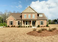 Brick exterior with stone accents. Spacious open floorplan. The Fleming | River Crest | Tyrone, GA