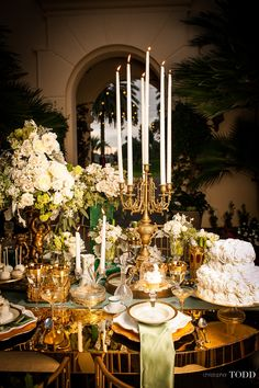 Holiday tablescapes/karen cox..French Buckets Floral Design, Christopher Todd Studios, Revelry Event Design: Gold Oval Mirrored Table