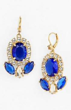 Making a shiny entrance in these sparkly blue and white drop earrings!