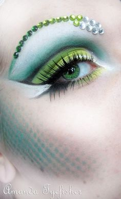 Makeup inspired by the scales of a tropical snake accented with a crystal brow.