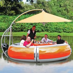 "The Barbecue Dining Boat - This unique 10 person boat lets you barbecue, dine, and enjoy the thrill of the open waters all at the same time. It features a 24"" diameter steel charcoal grill surrounded by an ABS table with 10 place settings, recessed plate holders, three beverage holders, and silverware trays for each setting, a retractable 11' diameter nylon umbrella, a 30-watt electric trolling motor and 6 compartments beneath the ABS seats to store food and supplies."