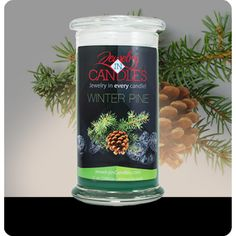 Capture the magic of Christmas all season long with this delightful pine aroma. Subtle wood tones support classic spruce notes for a fragrance that is smooth yet strong. Winter Pine Candle Infused with natural essential oils, including Patchouli, Cedarwood, Fir Needle and Spearmint. Full size 21oz scented candle 100% all natural Soy candle  Burns for 100 to 150 hours.  Includes a piece of jewelry in every candle.