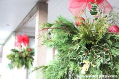 Use your summer hanging baskets to create Holiday greens arrangements