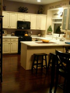 Cream colored cabinets on pinterest for Butter cream colored kitchen cabinets