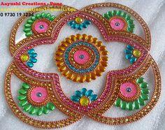 Kundan rangoli designs on pinterest diwali rhinestone for Agal vilakku decoration
