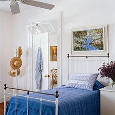 Key West Homes | Colonial Cool | CoastalLiving.comloe the transom window over the door and the batten board walls