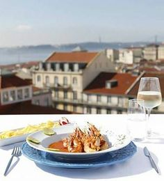 Taste flavourful Mozambique food and take in views of Lisbon's red rooftops on the terrace at Lisbon, Portugal's Zambeze.