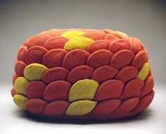 modern pouff made with hundreds of circular crochet motifs sewn together.