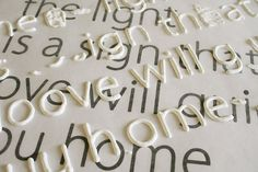 use puff paint to make your own letters on a canvas. print out the font you want and place wax paper over it. then use puff paint and trace. let it dry then use mod podge to secure them.