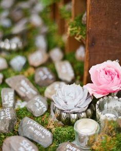 Sandy and Dwight built the stone walls of Sandy's former home together, so they turned rocks into escort cards at their reception to symbolize the support their guests gave to their relationship.