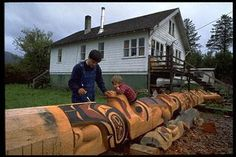 David Boxley, Tsimshian totem pole carver, working on a pole,
