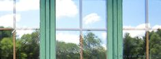 Summer reflected in the windows of the Kelley Nature Center on the Orange Trail at Camp #Yawgoog.  Image by David R. Brierley.