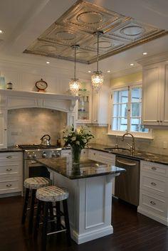 White victorian kitchen. Granite countertop, marble subway tile backsplash, dark oak hardwood, tin ceiling.
