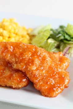 Honey Chipotle Chicken Crispers - Easy baked chicken tenders smothered in a sweet, tangy honey chipotle sauce!