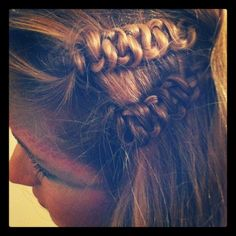 another serpent braid (regular braid and then you just hold the middle strand and gently push the other two up the strand)