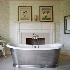 A masculine touch of grey steel on this free standing tub, very nice!