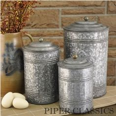 Galvanized Canisters - set of 3. An antique inspired set of three galvanized tin canisters are a great addition to the kitchen or laundry. Sizes:  Large: 11.5 x 7, Medium: 9.5 x 5.5, Small: 7.5 x 5. #country #prim #kitchen #pantry