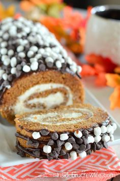 Pumpkin roll with a fun marshmallow and chocolate twist.