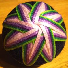 The front side of my second completed Temari ball.  The front side represents flower petals, the back side represents leaves.