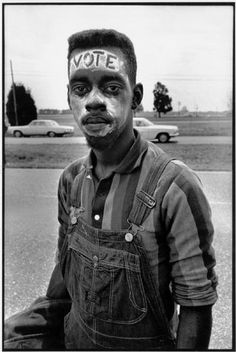 """ALABAMA—A young man with """"Vote"""" painted on his forehead walking in the Selma March, 1965."""