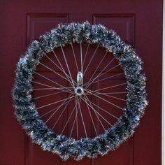 Repurposed bike wheel wreath.- use for all those christmas cards