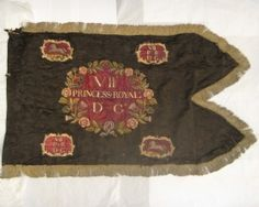 An extremely rare late Georgian 7th or Princess Royal's Dragoon Guards regimental guidon beautifully embroidered on black silk damask and finished with gold fringing.( Complete image)